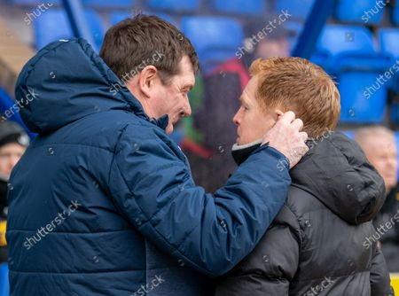 Stock Picture of St. Johsntone Manager Tommy Wright pinches Celtic Manager Neil Lennon's ear as they meet in the technical area before kick off.