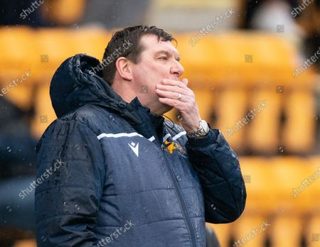 Stock Image of St. Johsntone Manager Tommy Wright covers his face with his hand in the technical area