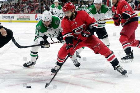 Tyler Seguin, Vincent Trocheck. Dallas Stars' Tyler Seguin (91) and Carolina Hurricanes' Vincent Trocheck (16) go for the puck during the first period of an NHL hockey game in Raleigh, N.C., on