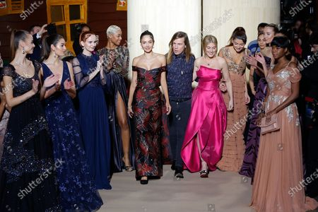 Stock Image of Christophe Guillarme and models on the catwalk