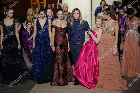 Christophe Guillarme and models on the catwalk