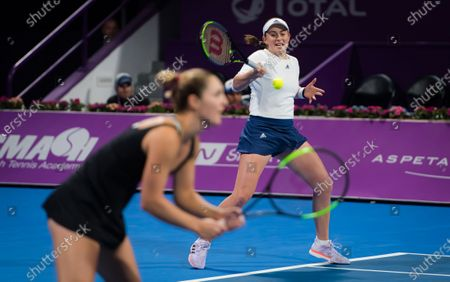 Jelena Ostapenko of Latvia & Gabriela Dabrowski of Canada in action during the doubles final of the 2020 Qatar Total Open WTA Premier 5 tennis tournament
