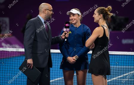 Jelena Ostapenko of Latvia & Gabriela Dabrowski of Canada after the doubles final of the 2020 Qatar Total Open WTA Premier 5 tennis tournament