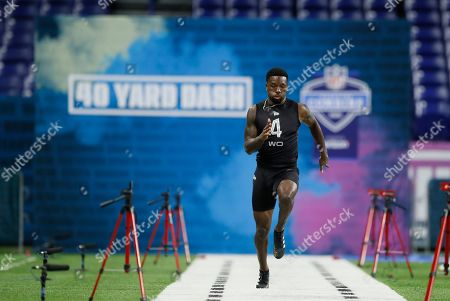 Colorado wide receiver Tony Brown runs the 40-yard dash at the NFL football scouting combine in Indianapolis