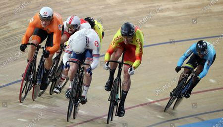 Jefrrey Hoogland (L) of Netherlands, Jason Kenny of Britain (2-L) and Juan Perlata of Spain (2-R) compete during the Men's Keirin First Round at the UCI Track Cycling World Championships in Berlin, Germany, 27 February 2020.