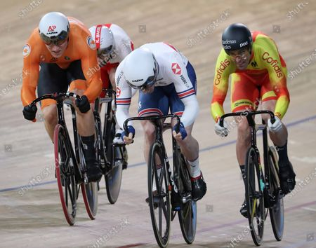 Jefrrey Hoogland (L) of Netherlands, Jason Kenny of Britain (C) and Juan Perlata of Spain (R) compete during the Men's Keirin First Round at the UCI Track Cycling World Championships in Berlin, Germany, 27 February 2020.