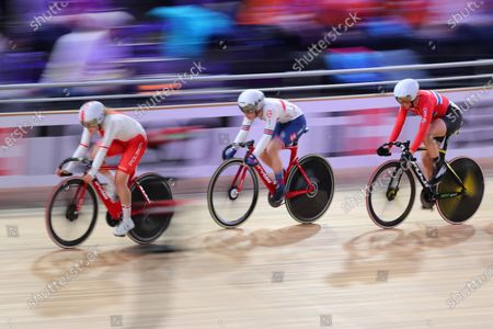 A slow shutter speed shot of Daria Pikulik of Poland, Laura Kenny of Great Britain and Kirsten Wild competing in the Women's omnium tempo race