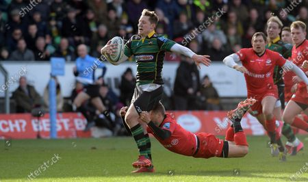 Northampton's Fraser Dingwall i(Left) s tackled just short of the tryline by Saracens' Richard Wigglesworth