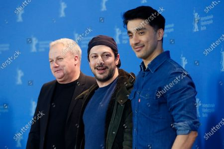 Producers Christian Springer, Fahri Yardim and Amir Hamz pose during the 'Curveball' photocall during the 70th annual Berlin International Film Festival (Berlinale), in Berlin, Germany, 27 February 2020. The movie is presented in the Berlinale Special section at the Berlinale that runs from 20 February to 01 March 2020.