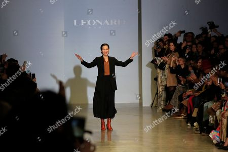 Fashion designer Yiqing Yin takes the stage after the presentation of Leonard fashion collection during Women's fashion week Fall/Winter 2020/21 presented in Paris