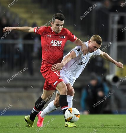 AZ Alkmaar's Oussama Idrissi (L) in action against LASK's James Holland (R) during the UEFA Europa League round of 32 second leg soccer match between LASK Linz and AZ Alkmaar in Linz, Austria, 27 February 2020.