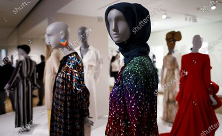 Stock Picture of Fashion designs, including a piece (C) by British fashion designer Mary Katrantzou, are displayed as part of the new exhibit 'Contemporary Muslim Fashion' at the Cooper Hewitt, Smithsonian Design Museum in New York, New York, USA, 27 February 2020. The exhibit is first major museum exhibit to 'explore the rise of modest fashion industry', according to the museum, and is intended to explore the ways in which Muslim women embrace and express style. The show, which runs from 28 February until 23 August 2020, features 80 ensembles and photographs.
