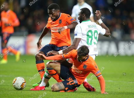 Basaksehir's Okechukwu Azubuike left, sties to dribble past Sporting's Yannick Bolasie, right, during their Europa League Group Round of 32 second leg soccer match between Basaksehir and Sporting Lisbon, in Istanbul