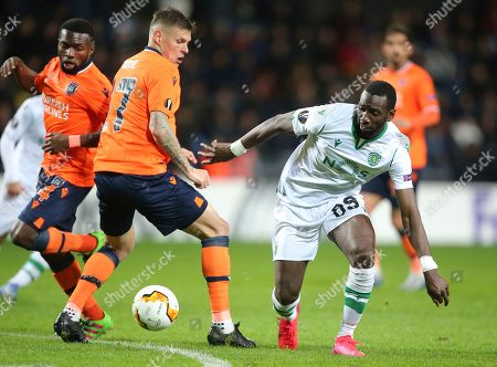 Basaksehir's Martin Skrtel, left, fights for th eball with Sporting's Yannick Bolasie, right, during their Europa League Group Round of 32 second leg soccer match between Basaksehir and Sporting Lisbon, in Istanbul