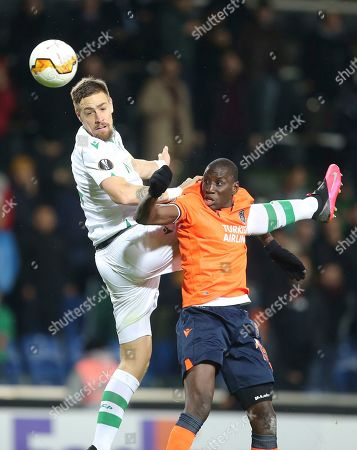Sporting's Sebastian Coates, left, and Basaksehir's Demba Ba, right, jump for th eball, during their Europa League Group Round of 32 second leg soccer match between Basaksehir and Sporting Lisbon, in Istanbul, . Basaksehir won the match 4-1
