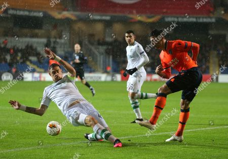 Sporting's Sebastian Coates, left, tries to stop Basaksehir's Danijel Aleksic, right, during their Europa League Group Round of 32 second leg soccer match between Basaksehir and Sporting Lisbon, in Istanbul