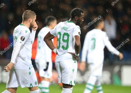 Sporting's Yannick Bolasie, centre, reacts after Basaksehir scored a goal against his team, during their Europa League Group Round of 32 second leg soccer match between Basaksehir and Sporting Lisbon, in Istanbul