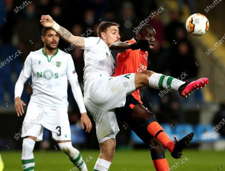 Basaksehir's Demba Ba (R) in action against Sporting's Sebastian Coates (L) during the UEFA Europa League round of 32, 2nd leg soccer match between Basaksehir Istanbul and Sporting CP at the Fatih Terim satdium in Istanbul, Turkey, 27 February 2020.