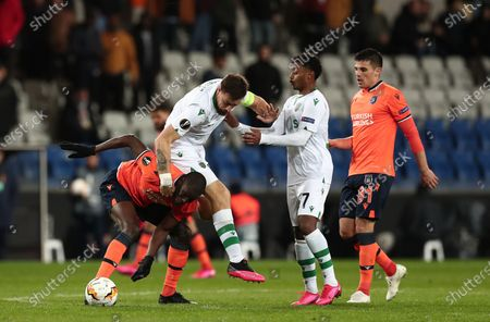 Basaksehir's Demba Ba (L) in action against Sporting's Sebastian Coates (2-L) during the UEFA Europa League round of 32, 2nd leg soccer match between Basaksehir Istanbul and Sporting CP at the Fatih Terim satdium in Istanbul, Turkey, 27 February 2020.