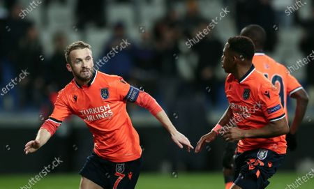 Basaksehir's Edin Visca (L) and Robinho (R) celebrate at the end of the UEFA Europa League round of 32, 2nd leg soccer match between Basaksehir Istanbul and Sporting CP at the Fatih Terim satdium in Istanbul, Turkey, 27 February 2020.