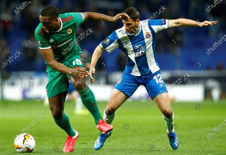 Wolverhampton Wanderers FC's Willy Boly (L) in action against RCD Espanyol's David Lopez (R) during the UEFA Europa League round of 32 second leg soccer match between Espanyol FC and Wolverhampton Wanderers at RCDE Stadium in Cornella de Llobregat, Barcelona, north eastern Spain, 27 February 2020.