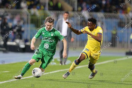 AL- Nassr's Ahmed Musa (R) in action against Al-Ahli's Marko Marin (L) during the Saudi Professional League soccer match between AL- Nassr and Al-Ahli at Prince Faisal bin Fahd Stadium, Riyadh, Saudi Arabia, 27 February 2020.