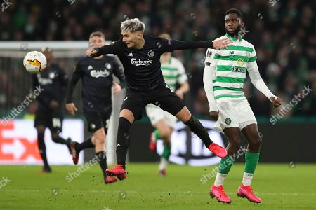 Copenhagen's Guillermo Varela, left, vie for the ball with Celtic's Odsonne Edouard during the Europa League round of 32, second leg soccer match between Celtic and FC Copenhagen at the Celtic Park stadium in Glasgow, Scotland