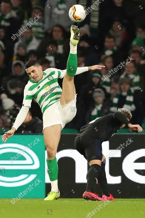 Celtic's Tom Rogic, left, vie for the ball with Copenhagen's Guillermo Varela during the Europa League round of 32, second leg soccer match between Celtic and FC Copenhagen at the Celtic Park stadium in Glasgow, Scotland