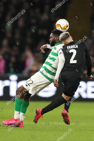 Celtic's Odsonne Edouard, left, goes for a header with Copenhagen's Guillermo Varela during the Europa League round of 32, second leg soccer match between Celtic and FC Copenhagen at the Celtic Park stadium in Glasgow, Scotland