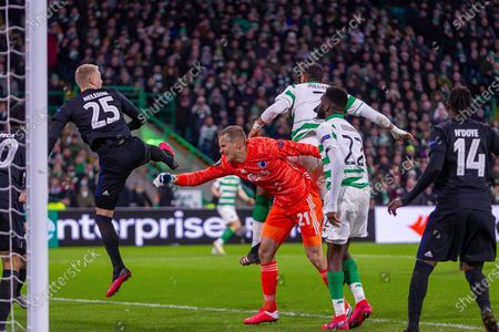 The foul that led to Celtic's goal being disallowed. Karl-Johan Johnsson of FC Copenhagen facing his own net when Christopher Jullien of Celtic FC jumps for the header during the Europa League match between Celtic and FC Copenhagen at Celtic Park, Glasgow