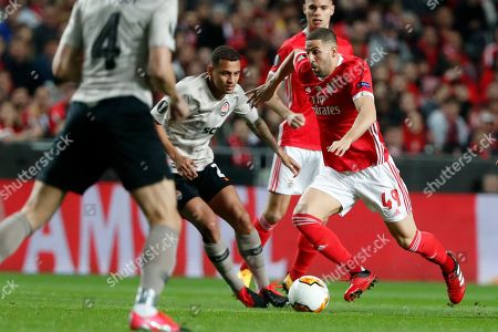 Benfica's Adel Taarabt runs with the ball during the Europa League round of 32 second leg soccer match between SL Benfica and Shakhtar Donetsk at the Luz stadium in Lisbon