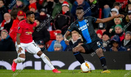 Manchester United's Fred (L) in action with Club Brugge's Naomichi Ueda (R) during the UEFA Europa League round of 32 second leg soccer match between Manchester United and Club Brugge held at Old Trafford in Manchester, Britain, 27 February 2020.