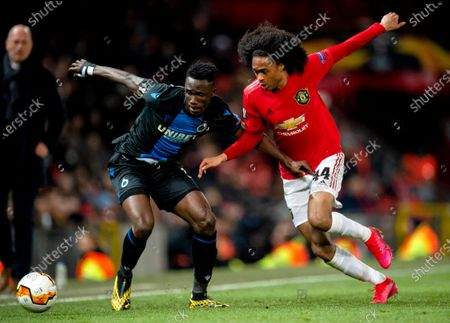 Club Brugge's Naomichi Ueda (L) in action with Manchester United's Tahith Chong (R) during the UEFA Europa League round of 32 second leg soccer match between Manchester United and Club Brugge held at Old Trafford in Manchester, Britain, 27 February 2020.