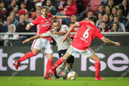 Benfica players Adel Taarabt (L) and Ruben Dias (R) fight for the ball with Ismaily of Shakhtar Donetsk during the UEFA Europa League soccer match Benfica vs Shakhtar Donetsk at Luz Stadium in Lisbon, Portugal, 27 February 2020.