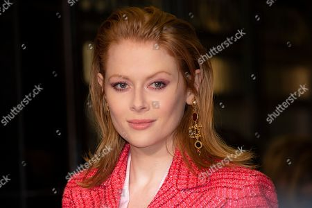 Emily Beecham poses for photographers upon arrival at the UK premiere of 'Sulphur and White' at a central London cinema