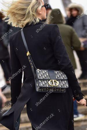 Street Style at Ann Demeulemeester show, Dior purse detail