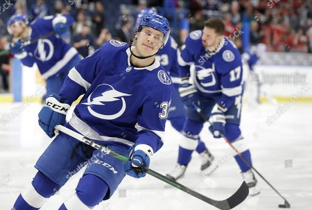 Tampa Bay Lightning center Yanni Gourde (37) before an NHL hockey game against the Chicago Blackhawks, in Tampa, Fla