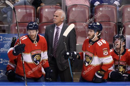 Florida Panthers coach Joel Quenneville watches during the second period of the team's NHL hockey game against the Toronto Maple Leafs, in Sunrise, Fla. Quenneville became the second NHL head coach to reach 1,700 games