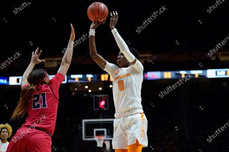 Rennia Davis #0 of the Tennessee Lady Vols shoots the ball over Taylor Smith #21 of the Ole Miss Rebels during the NCAA basketball game between the University of Tennessee Lady Volunteers and the University of Mississippi Rebels at Thompson Boling Arena in Knoxville TN Tim Gangloff/CSM