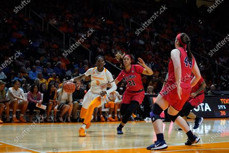 Rennia Davis #0 of the Tennessee Lady Vols drives to the basket against Taylor Smith #21 of the Ole Miss Rebels during the NCAA basketball game between the University of Tennessee Lady Volunteers and the University of Mississippi Rebels at Thompson Boling Arena in Knoxville TN Tim Gangloff/CSM