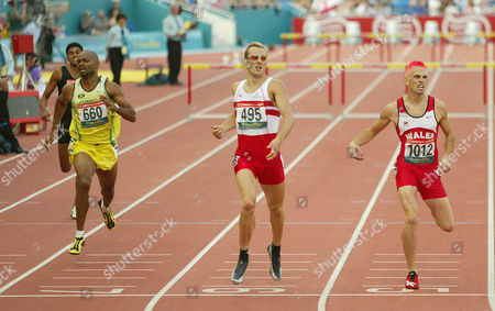 17th Commonwealth Games Manchester 2002. Mens 400m Hurdles Final. Chris Rawlinson Of England (495) And Matthew Elias Of Wales (1012) In Action. Rawlinson Won The Gold Elias The Silver.