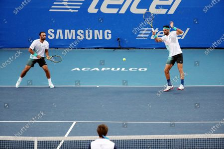Juan Sebastian Cabal (L) and Robert Farah (R) of Colombia in action against Sander Gille and Joran Vliegen of Belgium during a game of the Mexican Tennis Open held in Acapulco, in the state of Guerrero, Mexico, 27 February 2020.
