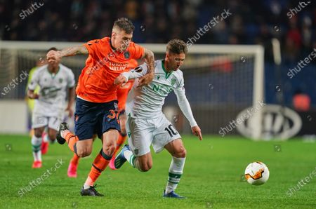 Luciano Vietto of Sporting CP and Martin Skrtel of Istanbul Basaksehir FK challenging for the ball during Istanbul BaÅYakÅYehir and Sporting CP on BaÅYakÅYehir Fatih Terim Stadium, Istanbul, Turkey