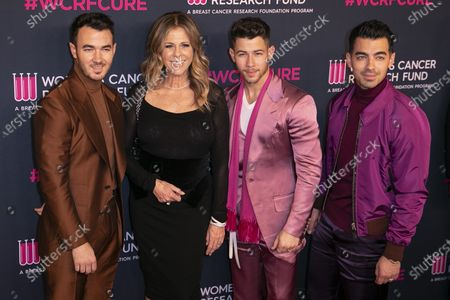 Kevin Jonas, US actress Rita Wilson, US musicians Nick Jonas and Joe Jonas attend the Women's Cancer Research Fund gala at the Beverly Wilshire Hotel in Beverly Hills, California, USA, 27 February 2020.