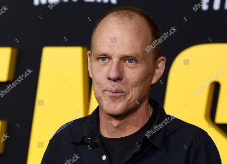 """Brian Helgeland, a writer on the Netflix film """"Spenser Confidential,"""" poses at the world premiere of the film at the Regency Village Theatre, in Los Angeles"""