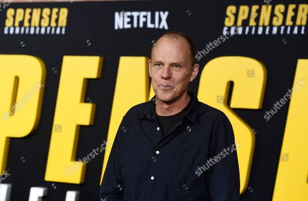 "Stock Picture of Brian Helgeland, a writer on the Netflix film ""Spenser Confidential,"" poses at the world premiere of the film at the Regency Village Theatre, in Los Angeles"