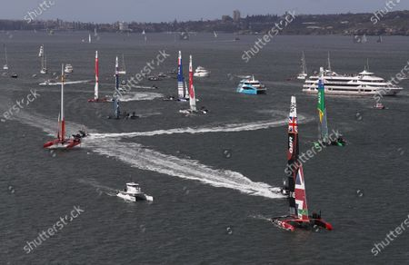 Great Britain SailGP Team helmed by Ben Ainslie cutting leading the fleet during the race on day 1. Sydney SailGP, Event 1 Season 2 in Sydney Harbour, Sydney, Australia. 28 February 2020. Photo: David Gray for SailGP. Handout image supplied by SailGP