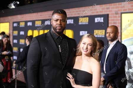 US-Tobagonian actor Winston Duke (L) and US comedian Iliza Shlesinger (R) arrive at the premiere of the Netflix film Spenser Confidential, at the Regency Village Theater in Los Angeles, California, USA, 27 February 2020.