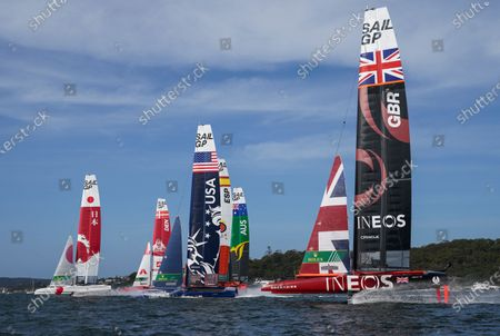 Great Britain SailGP Team helmed by Ben Ainslie prepares to overtake the fleet at the start of the first race on Race Day 2. Sydney SailGP, Event 1 Season 2 in Sydney Harbour, Sydney, Australia. 29 February 2020. Photo: Bob Martin for SailGP. Handout image supplied by SailGP