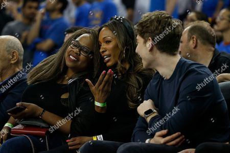 Stock Photo of Cari Champion, center, attends an NCAA college basketball game between UCLA and Arizona State, in Los Angeles